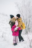 Happy family detained in each other`s arms. Family spends time together in the winter Stock Photography