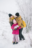 Happy family detained in each other`s arms. Family spends time together in the winter Royalty Free Stock Photos