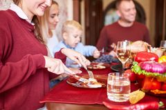 Happy family dining on Christmas on a blurred festive background. Celebrating Thanksgiving concept. Happy new year. Beautiful family dining at the festive table royalty free stock photos