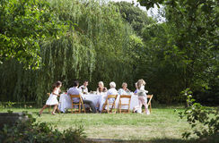 Happy Family Dining Together In Garden Stock Photo
