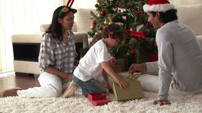 Happy family discovering the gifts on Christmas day stock video