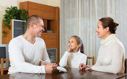 Happy family with documents royalty free stock photography