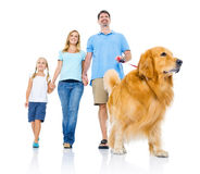 Happy Family with a Dog Stock Images