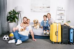 happy family with dog in bedroom ready Royalty Free Stock Photo