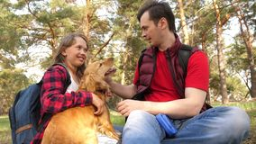 Happy family with a dog and children in a camping trip. Carefree teenagers with their father on a day off. Hiking. Happy family with dog and children in camping royalty free stock photography