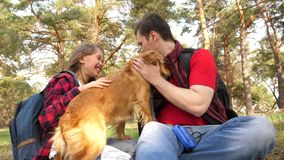 Happy family with a dog and children in a camping trip. Carefree teenagers with their father on a day off. Hiking. Happy family with dog and children in camping royalty free stock image