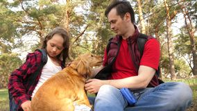Happy family with a dog and children in a camping trip. Carefree teenagers with their father on a day off. Hiking. Happy family with dog and children in camping stock photos