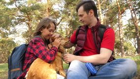 Happy family with a dog and children in a camping trip. Carefree teenagers with their father on a day off. Hiking. Happy family with dog and children in camping stock images