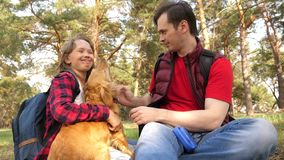 Happy family with a dog and children in a camping trip. Carefree teenagers with their father on a day off. Hiking. Happy family with dog and children in camping royalty free stock images