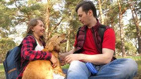 Happy family with a dog and children in a camping trip. Carefree teenagers with their father on a day off. Hiking. Happy family with dog and children in camping stock photo