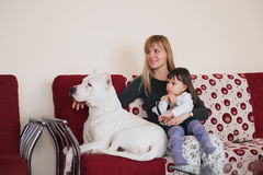 Happy family with dog at home. Royalty Free Stock Photos