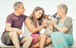 Happy family with dog. In Santa monica, Los angeles. concept about people, family and happiness Royalty Free Stock Photos