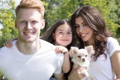 Happy family with dog royalty free stock photo