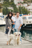 Happy family with dogs on the Quay in the summer Royalty Free Stock Photography