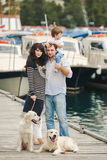 Happy family with dogs on the Quay in the summer Royalty Free Stock Image