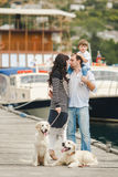 Happy family with dogs on the Quay in the summer Royalty Free Stock Photos