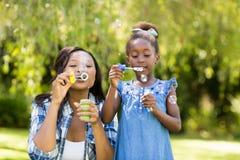 Happy family doing bubbles Royalty Free Stock Photos