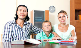 Happy family doing homework Royalty Free Stock Photo