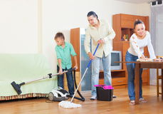 Happy family doing house cleaning Royalty Free Stock Photo