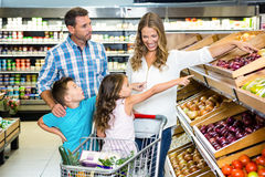 Happy family doing shopping. In grocery store Stock Photography