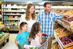 Happy family doing shopping Royalty Free Stock Image