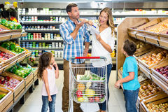 Happy family doing shopping. In grocery store stock images