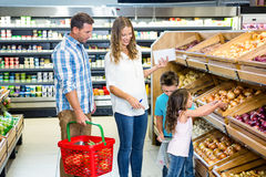 Happy family doing shopping Stock Photography