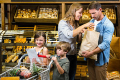 Happy family doing shopping. In grocery store royalty free stock photography