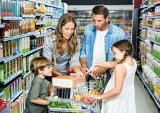 Happy family doing shopping. In grocery store Royalty Free Stock Photo