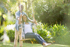 Happy family doing swing Royalty Free Stock Images