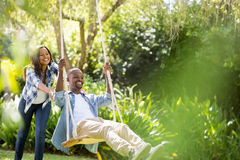 Happy family doing swing Royalty Free Stock Photos
