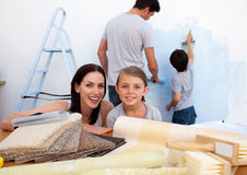 Happy family doing up their new home Stock Photos
