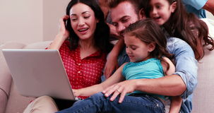 Happy family doing video chat on laptop stock video footage