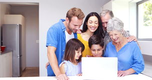 Happy family doing video chat on laptop. At home stock footage