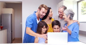Happy family doing video chat on laptop stock video