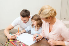 Happy family drawing at home Stock Images