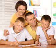 Happy family drawing with pencils Royalty Free Stock Images