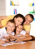 Happy family drawing with pencils. Happy family drawing with colorful pencils at the table together Stock Photo