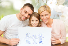 Happy family with drawing or picture Royalty Free Stock Image