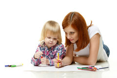 Happy family drawing picture. Royalty Free Stock Photography