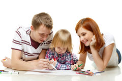 Happy family drawing picture. Royalty Free Stock Images