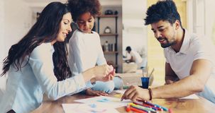 Happy family drawing and spending time together. At home Royalty Free Stock Photo