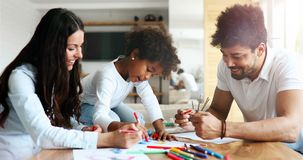 Happy family drawing and spending time together. At home Royalty Free Stock Image