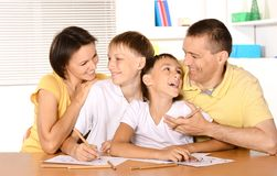 Happy family drawing. At the table together Royalty Free Stock Photo