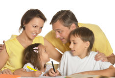 Happy family drawing. At the table together Stock Photos