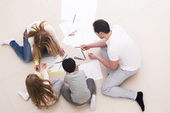 Happy family drawing together Stock Photo