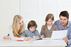 Happy family drawing together Stock Image