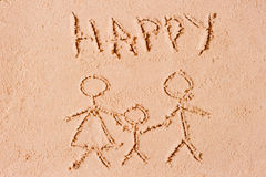 Happy family is drawn in sand Stock Image