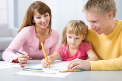 The happy family draws Royalty Free Stock Images
