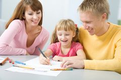 Happy family draws Stock Photos